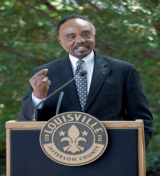 Portrait of Clifton Taulbert at a lectern